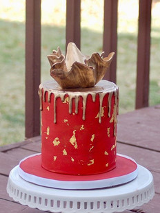Copper red cake with gold leaf, gold dri