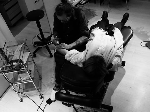 Tattoo_Artist_at_work.jpeg