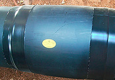Технология изоляции стыка труб ППУ с помощью электросварных муфт. Готовый электросварной стык имеет бочкообразную форму.