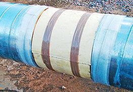 изоляция стыков надземной прокладки с помощью ППУ-скорлуп