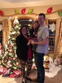 Amanda with her husband, Dan, and daughter, Violet, at home