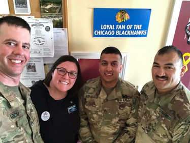 Amanda with her husband and two soldiers she served with in Afghanistan, March 2018