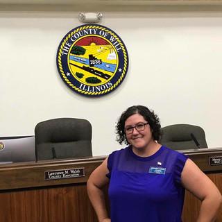 Amanda on the floor of the County Board room