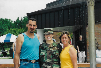 Amanda the day before graduating basic training with her parents August 2003