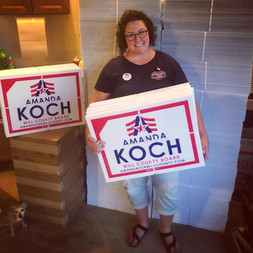 Amanda with her campaignsigns