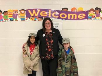 Amanda with girl scouts in her old uniforms after a Veterans Day presentation, November 2017