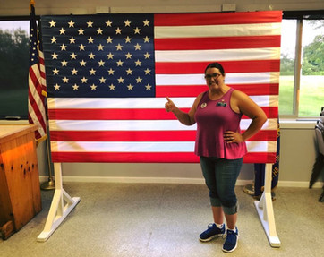 Amanda after setting up the flag she donated to the Frankfort VFW