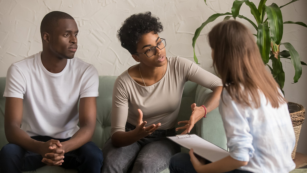 A couple discusses the infidelity in their relationship to a therapist in order to heal