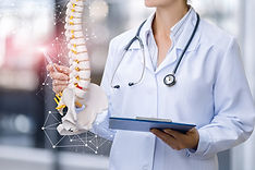 A medical worker shows the spine on blur