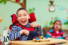 cheerful boy with disability at rehabili