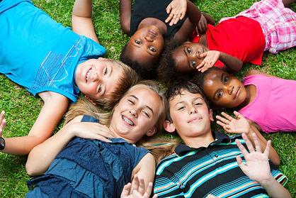 Diverse multiracial group of kids laying