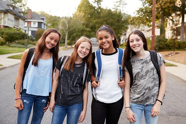 Teen girls on the way to school looking