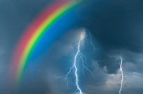 Colorful rainbow over water, thunderstorm with rain and lightning on background_edited.jpg