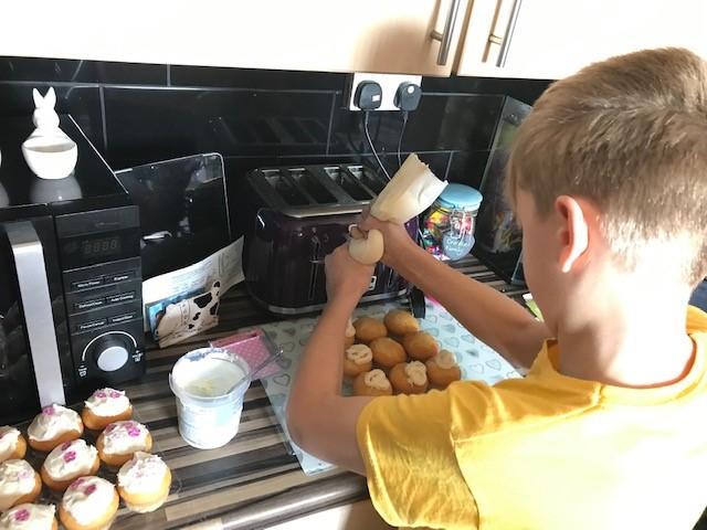 Blake Crooke (Y4) decorating cakes