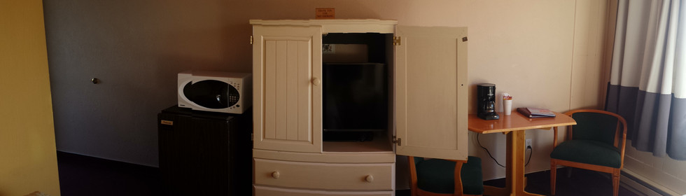 tv stand, microwave and coffee pot
