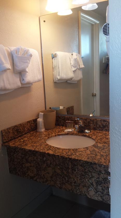 bathroom vanity includes hair dryer