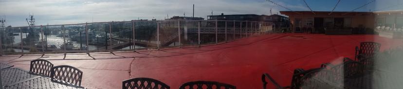 view of event deck and marina