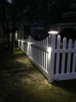 Low Voltage Lighting Cap On A Picket Fence