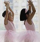 Two pink-tutu ballerinas.