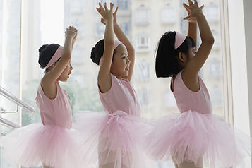Ballerina and dancers