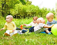 7367469-babies-playing-with-ball-in-the-