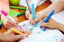 Children writing in a group therapy session