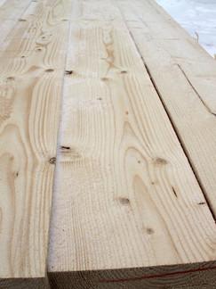 Fresh sawn whitewood surface.