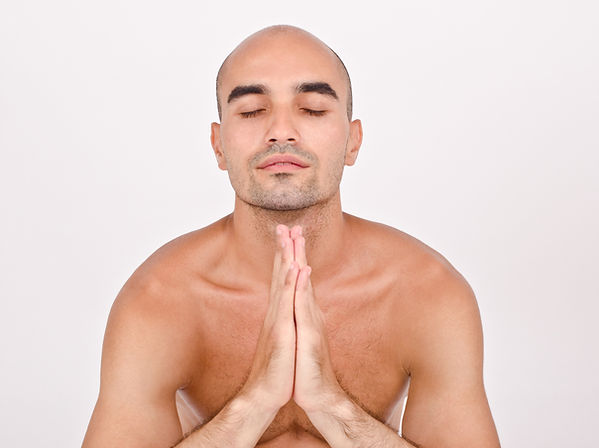A bald praying to grow more hair