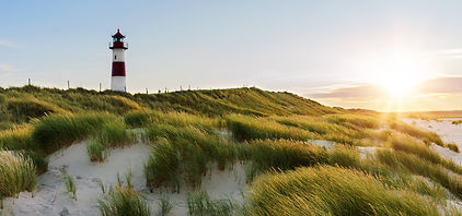 Lighthouse List East at sunset with suns