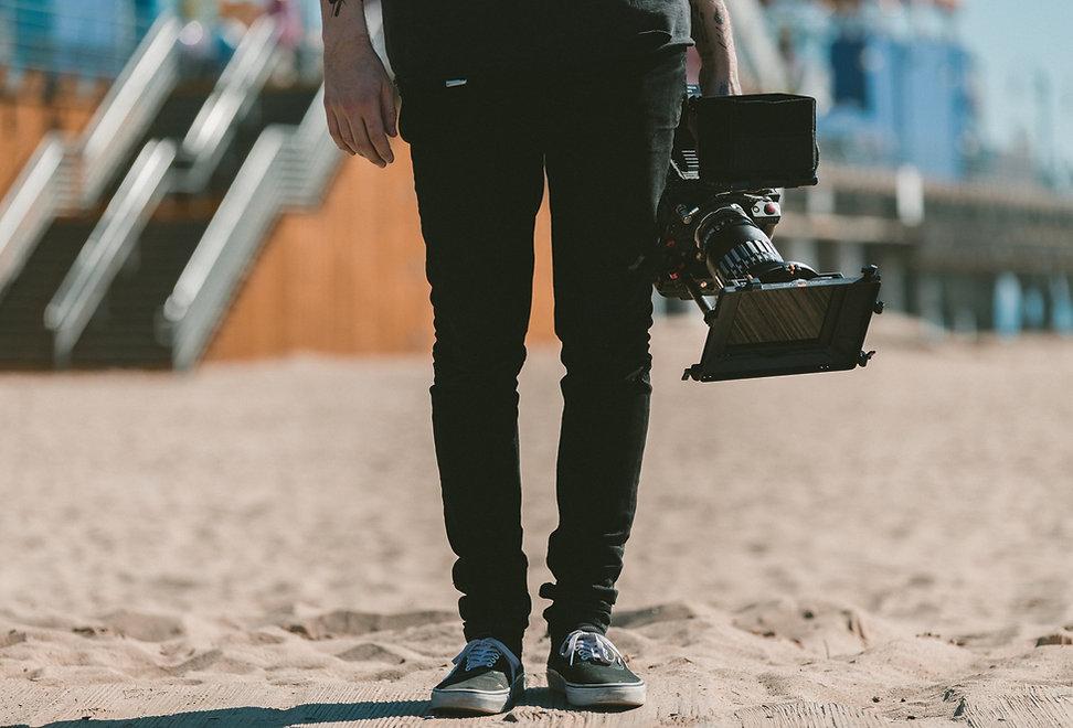Man%20Holding%20Camera_edited.jpg