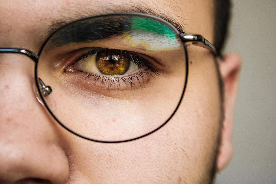 Portrait of man with brown eyes wearing eye glasses