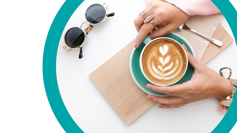 A woman's hands around a latte on a white background with wood board__edited.jpg