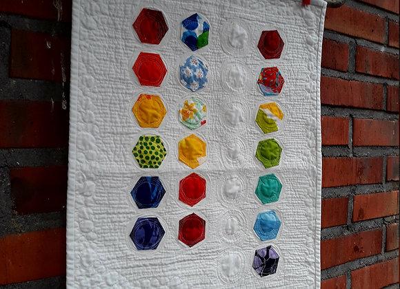 Modern wall hanging from Marimekko fabric