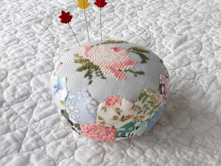Round hexagon pincushion with embroidery