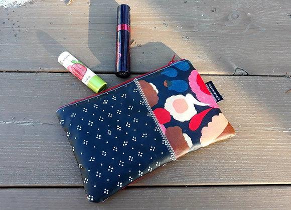 Waterproof zipper pouch from Marimekko oilcloth fabric Muija and Tuppurainen