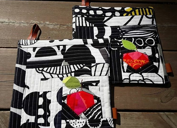 Black and white patchwork apple potholders from Marimekko fabric