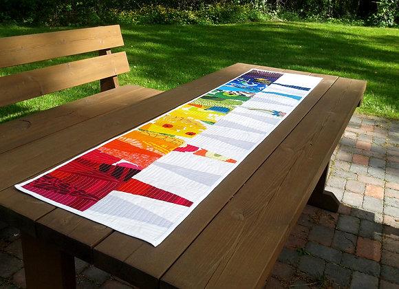 Rainbow patchwork table runner / wall hanging from Marimekko fabric