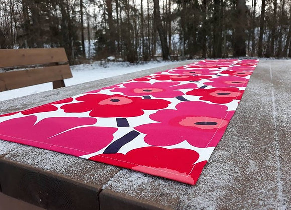 Red and pink table runner from Marimekko fabric Pieni Unikko