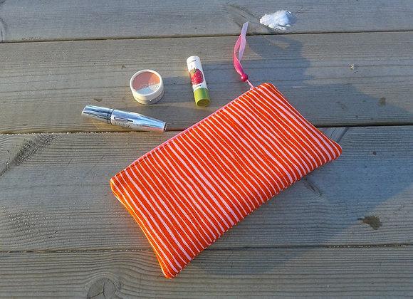 Orange zipper pouch from Marimekko fabric Varvunraita