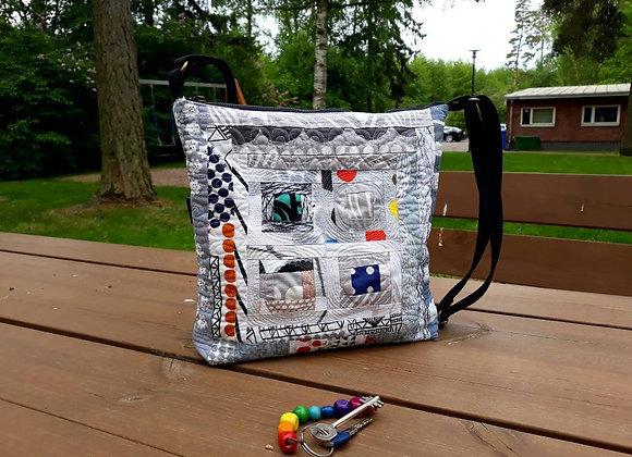 Modern gray patchwork cross body bag from Marimekko fabric