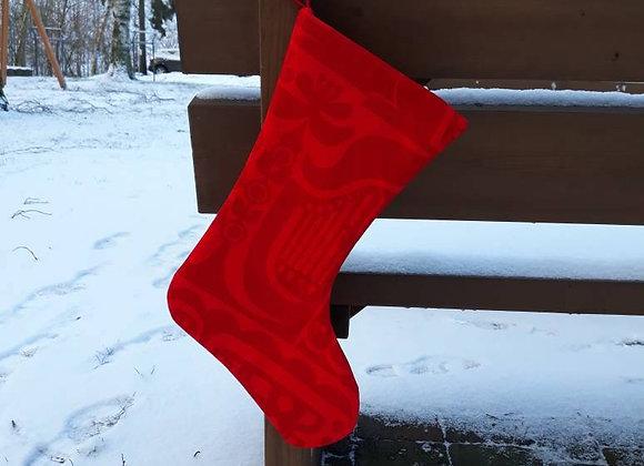 Red Christmas stocking from Marimekko fabric Kanteleen kutsu