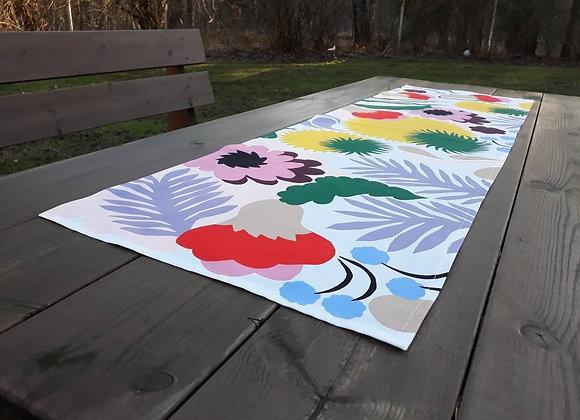 Floral table runner from Marimekko fabric Ojakelukka