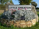 Little Smeaton village sign and flower box