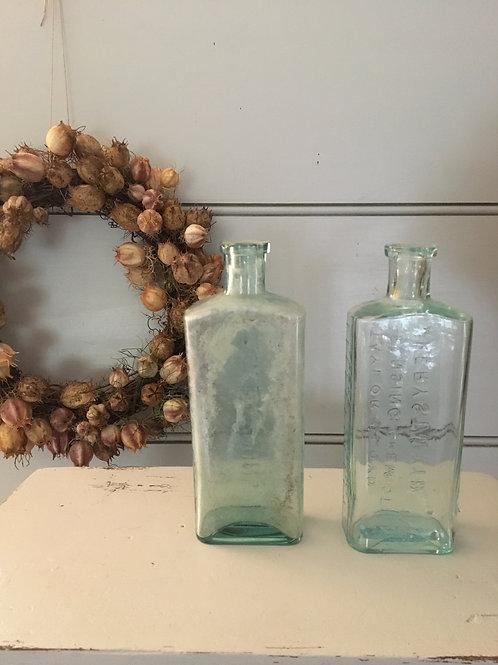A pair of Vintage Glass Medicine Bottles