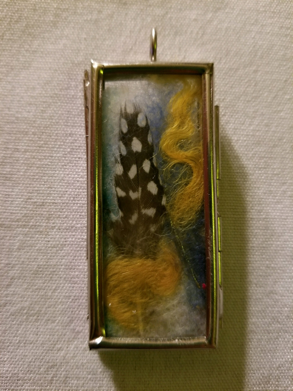 Windowpane Mixed Media flat pendant with feather