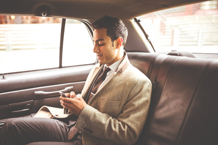 Businessman%20in%20a%20Car_edited.jpg