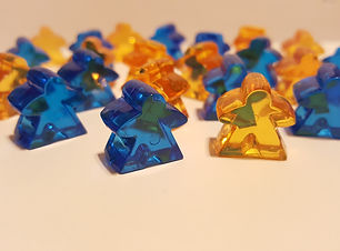 lots of meeples, game components, tokens, board game