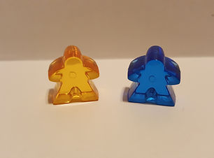 Two meeples, game components, board games