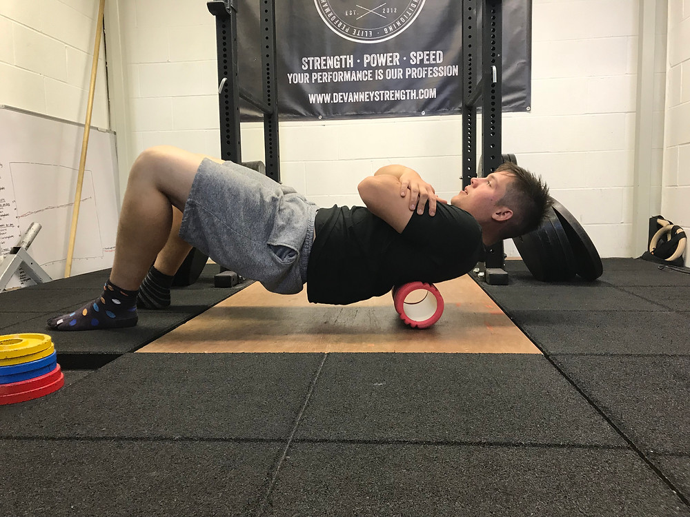 Increasing Thoracic extension using the foam roller.