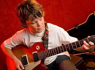 boy-playing-guitar-jbryson-istockphoto.j